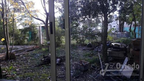 terreno con casa en moreno la reja