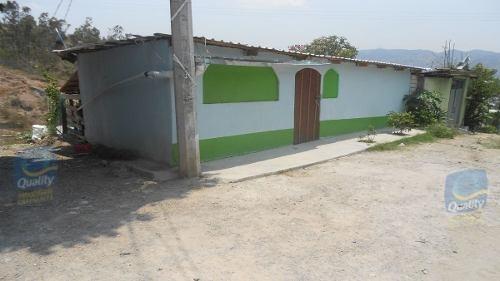 terreno con construcción