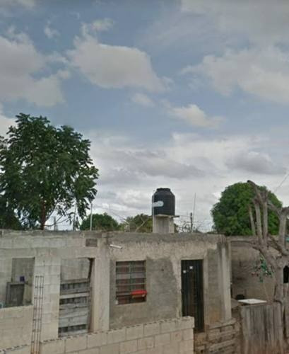 terreno con construcción semiterminada