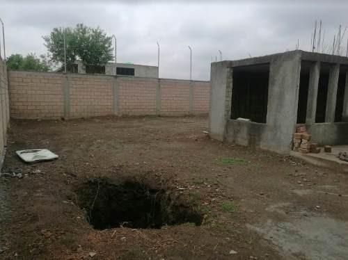 terreno con obra negra en venta