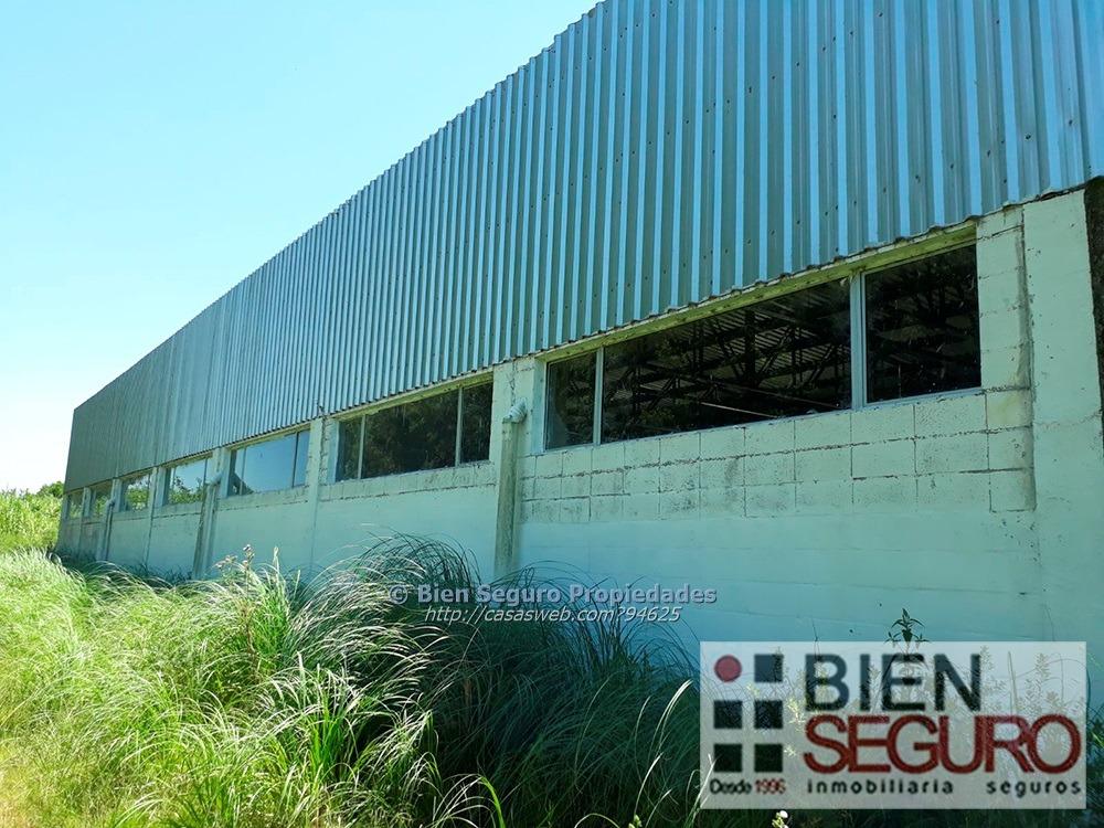 terreno de 16715 m2 con local industrial