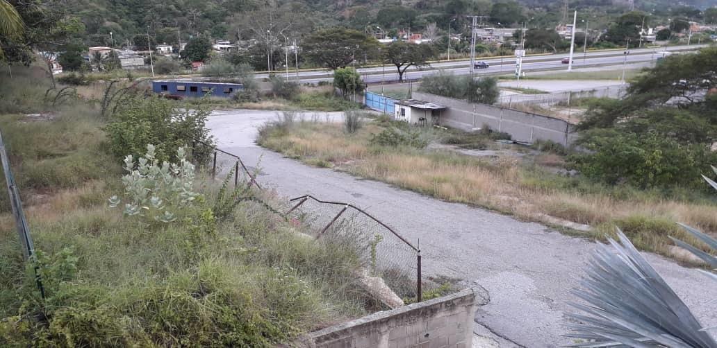 terreno de asfaltadora, edif. y estacionamiento 102