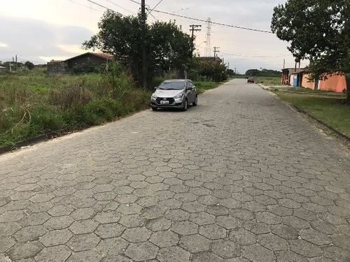 terreno em rua pavimentada, 1,3 km da praia, em itanhaém