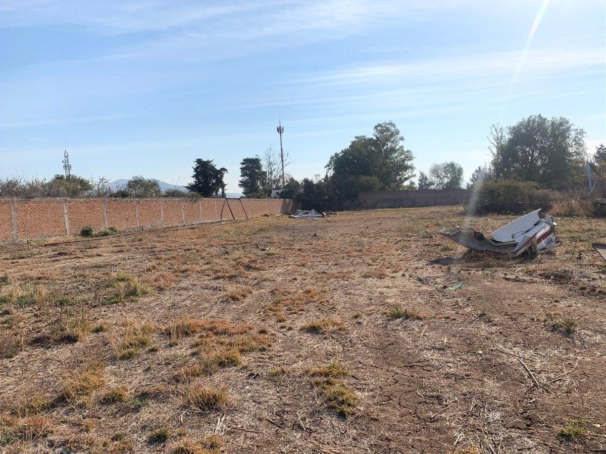 terreno en venta 5,000 metros con barda perimetral a 9 minutos de plaza alaia