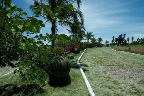 terreno plano en residencial hacienda yexthó