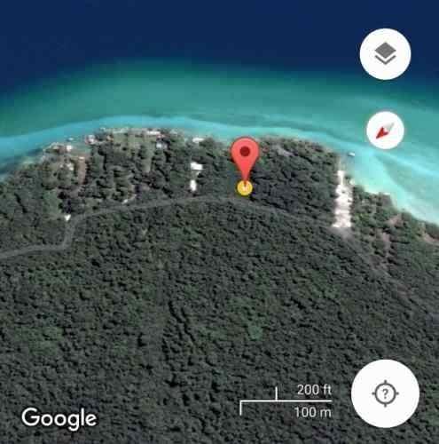 terreno ubicado por cayuco maya con frente de laguna