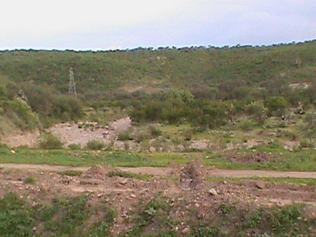 terreno,pozo compartido,casa de campo,huerta o granja .