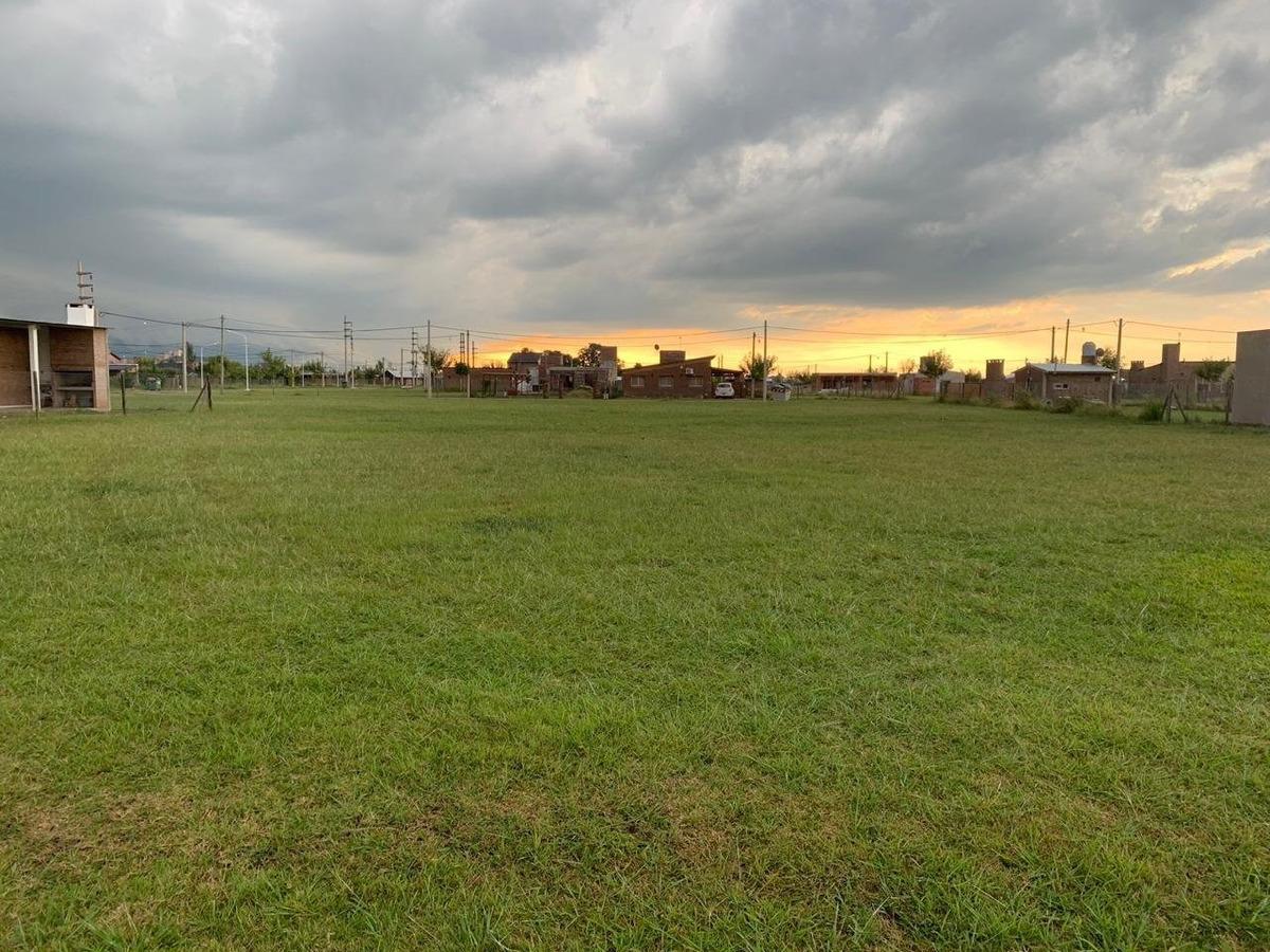 terrenos en barrio abierto punta chacra roldan.