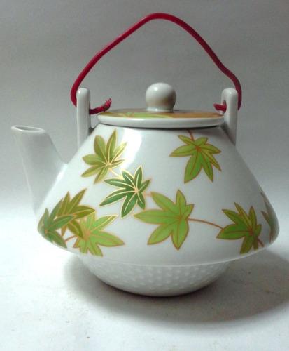 tetera porcelana blanca hojas verdes multiple choice