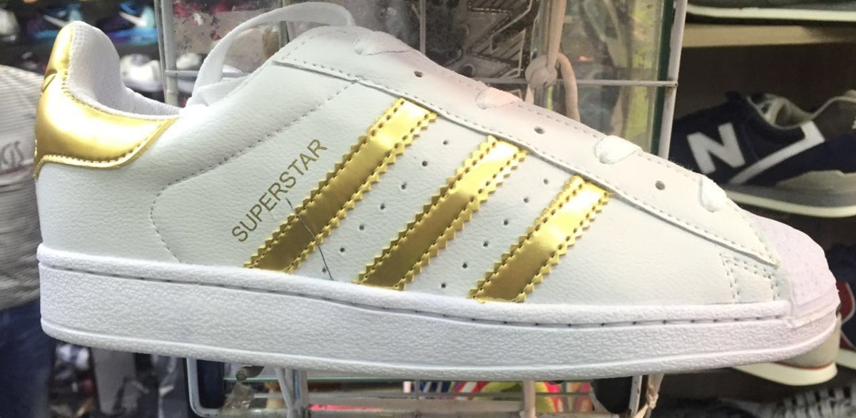 d89966cd39 ... superstar foundation branco dourado d4aa7 6007b wholesale tênis adidas  feminino. carregando zoom.
