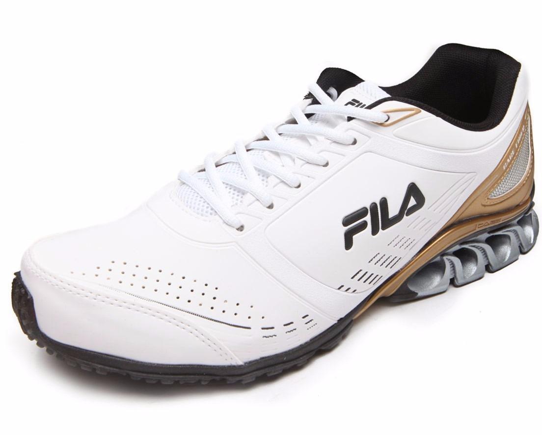 1f502e7cce1 tênis fila cage fiber feminino e masculino branco e dourado. Carregando  zoom.