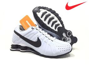 c66db1c7313 Tenis Nike Shox Junior 4 Molas Preto Com Azul Original - Tênis no ...