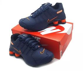 ab231f34b7 Tênis Nike Nz Masculino E Feminino Foto Original Azul-laranj
