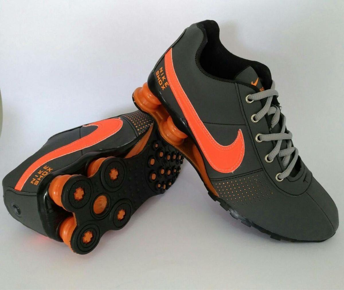 ... professional sale f402f ce2eb ... tênis nike shox 4 molas cinza  laranja. carregando ... d0a61856017e1