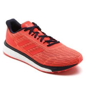 7f51e309c Tênis Run adidas Feminino Coral Response Boost Techfitbb3627