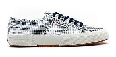 tênis superga branco com bolinhas azuis.