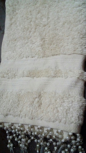 toalla de cara home collection con apliques decorativos