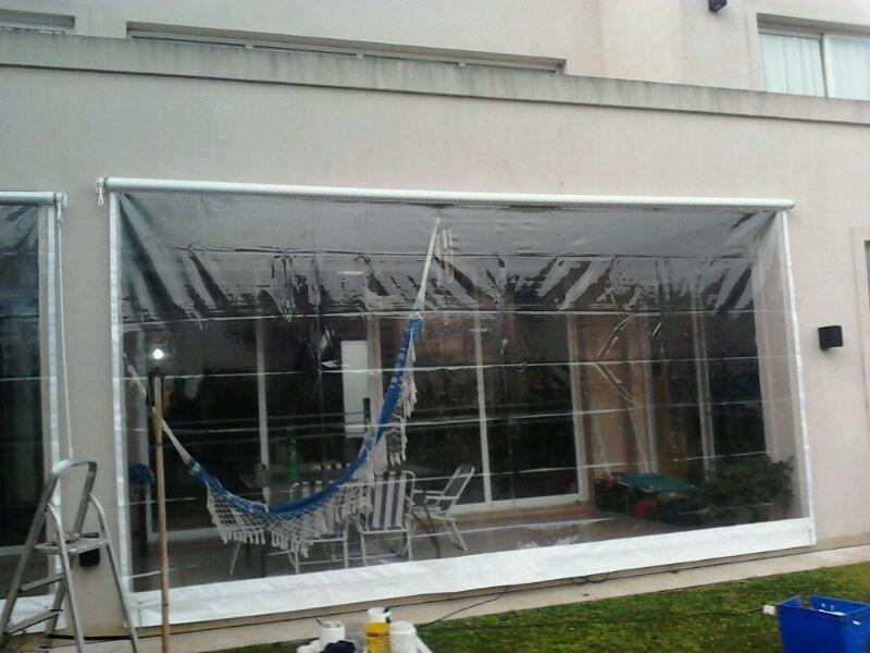 Toldo vertical enrollable de lona cristal somos for Toldos para balcones capital federal