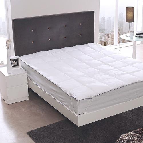 topper sencillo sobre colchón