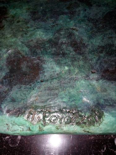 toro de bronce grande firmado.pesa 17kg
