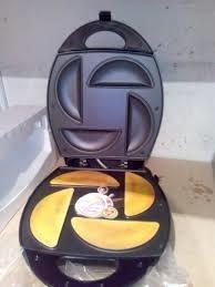 tosti empanadas oster