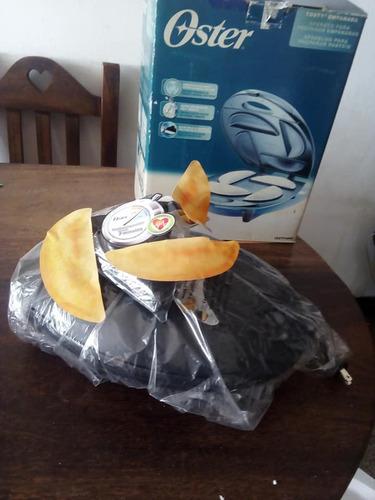 tosty empanada oster