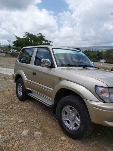 toyota prado -sumo gx 2003 dorada 3 puertas