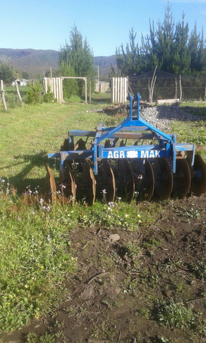 tractor con rastra