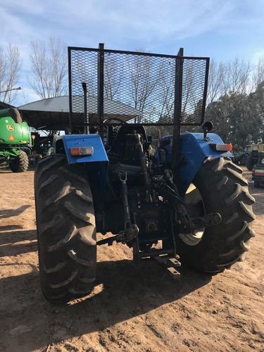 tractor new holland tl75,usado con pala frontal.