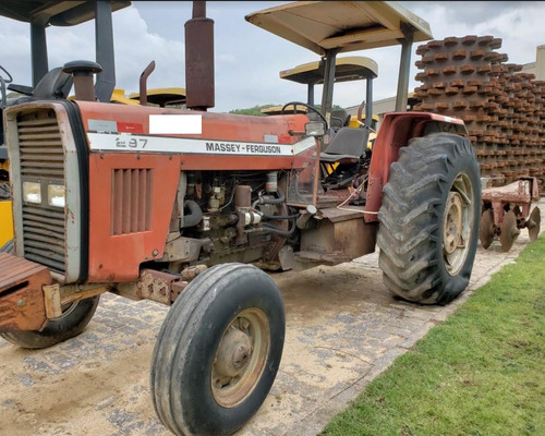 trator agrícola massey ferguson 297 com grade aradora