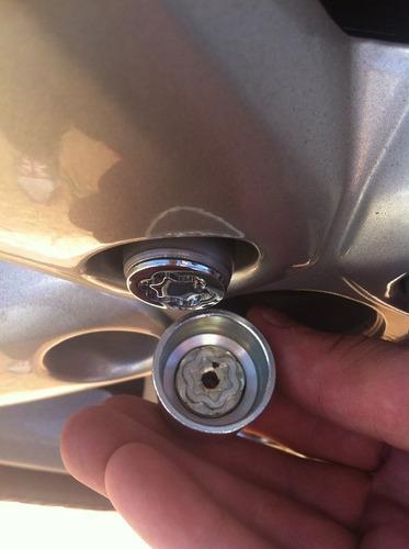 trava anti-furto mcgard p/ rodas e estepe - gm cobalt