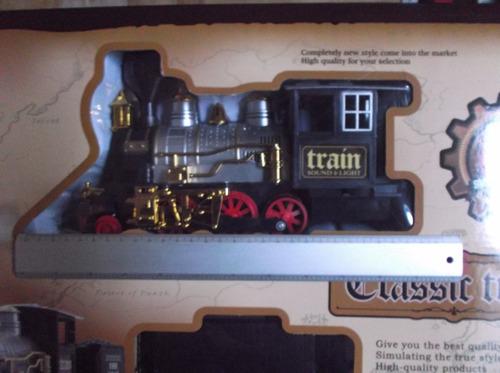 tren de juguete pilas luz sonido  y vias.