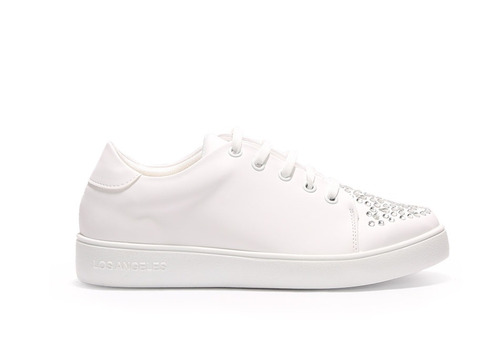 trender tenis color blanco con piedras