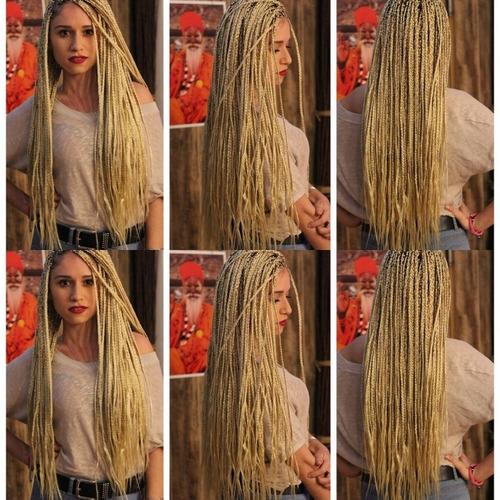trenzas africanas hechas por una africana con pelos incluido