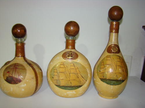 tres botellas italianas en cuero