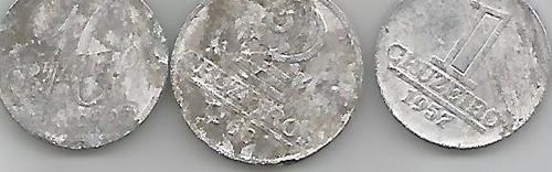 tres moedas de aluminio