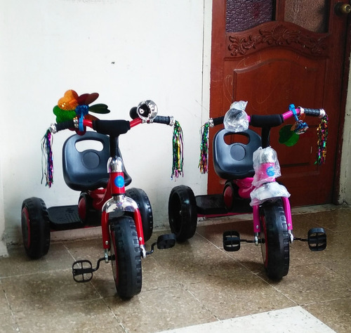 triciclos llantas led musicales. nuevos de paquete