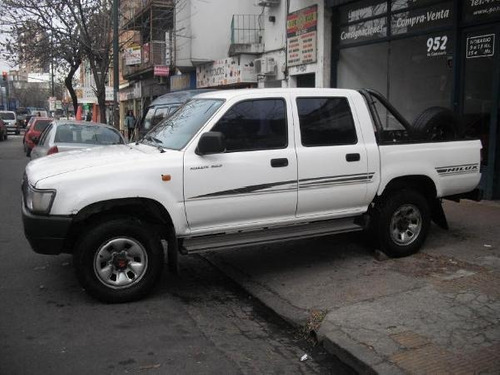 tun adhesivos laterales toyota hilux dx 3.0 año 2001