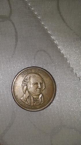 una modena de 1 dolar de  john adams del año 1797-1801