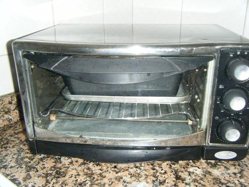 util y practico horno oster color negro y plateado