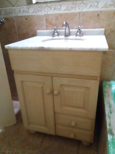 vanitory baño con vacha y griferia.