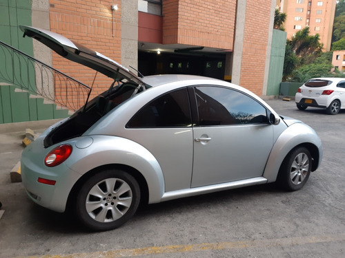 vencambio excelente vw new beetle