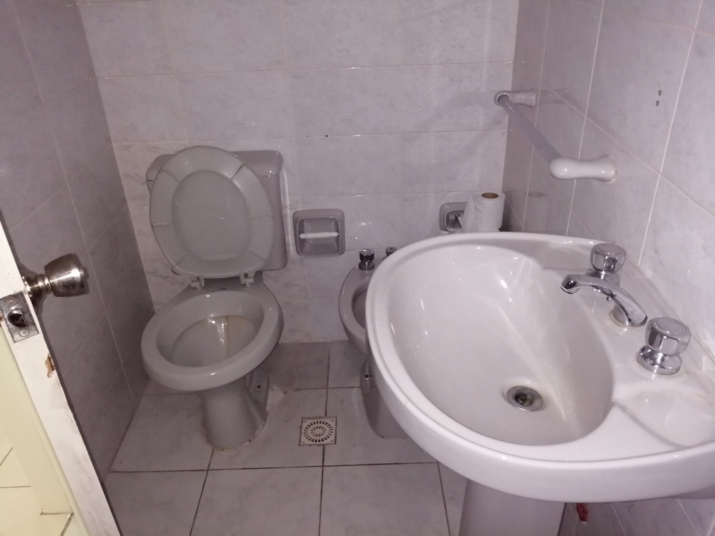 venda apto ambiente dividido con baño completo y cocina defi