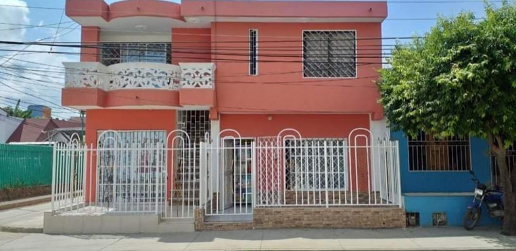vendo casa comercial de 4 apartamentos esquinera