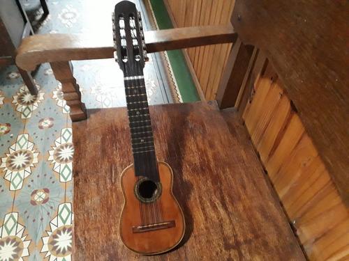 vendo  charango  y metodo para flauta traversa taffanel