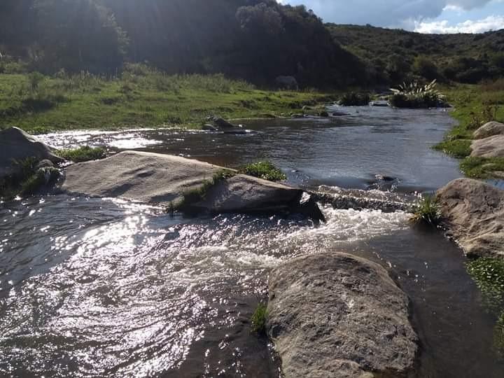 vendo complejo de cabañas en huerta grande con río propio