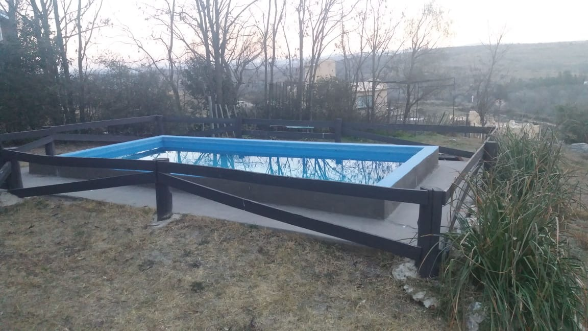vendo dos cabañas de troncos con piscina en villa giardino