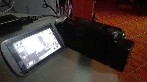 vendo o cambio filmadora canon vixia hf r400 más 3 sd