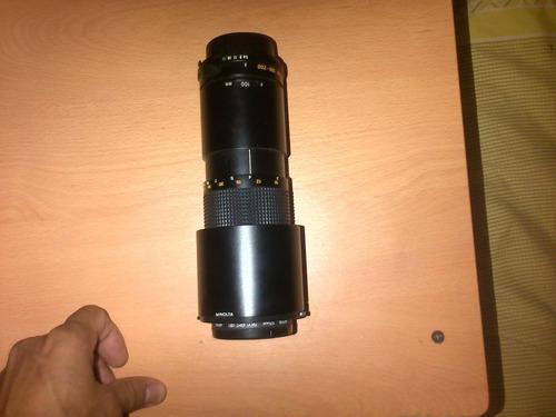 vendo o cambio lente minolta zoom 100-200 mm 1:5.6 de japón