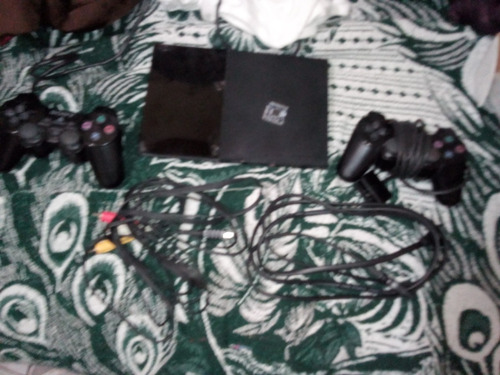 vendo o cambio play station 2 slim con chip matrix
